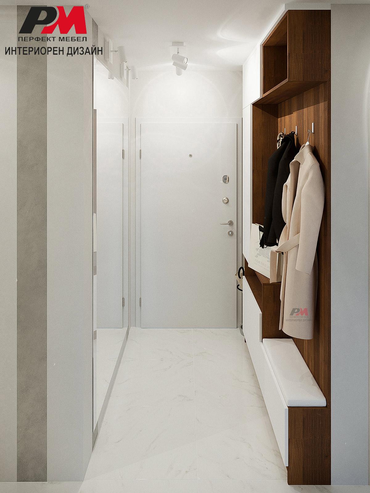 Функционално и практично антре в бял цвят и дървесен декор.